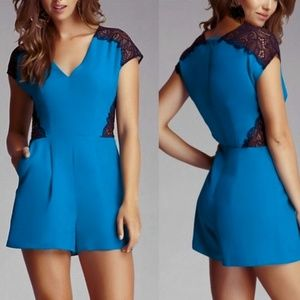Bebe bright blue romper with lace insets